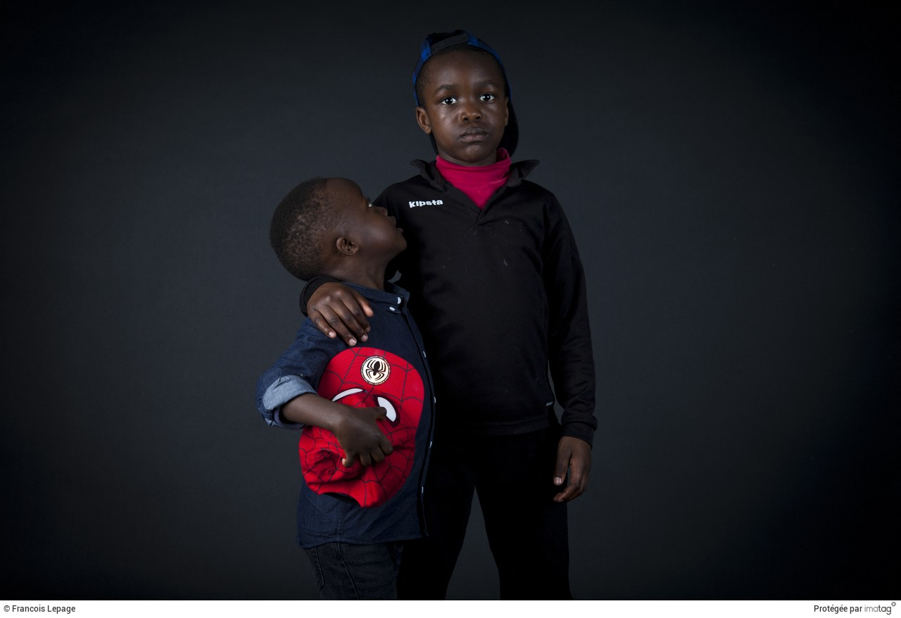 Young refugees during a photo session in a squat known  as Jardins de la Poterie